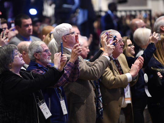 Crowd members photograph President Donald Trump at his speech to the American Farm Bureau Federation at Gaylord Opryland Resort & Convention Center Monday, Jan. 8, 2018 in Nashville, Tenn.