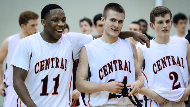 Central's Onterio Edmonds (11) Jared Wagner (24) and Garrett Markey walk off the court after the Panthers defeated Spring Grove 53-50, Tuesday Dec. 8, 2015. (John A. Pavoncello - The York Dispatch)