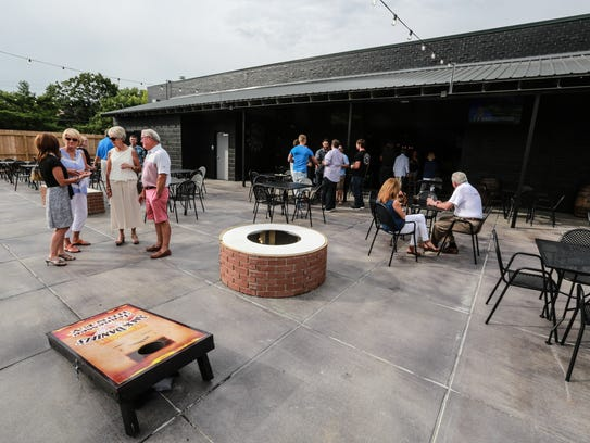 The outdoor patio at Blind Owl Brewery offers two fire