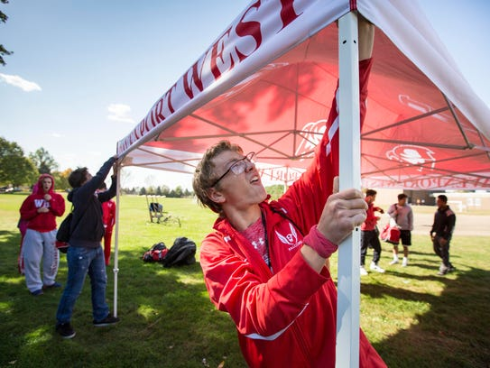 Davenport West's Tyler Gerdt helps set up their cross
