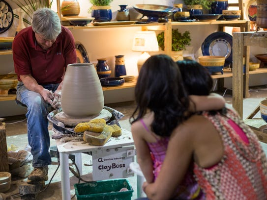 A mother and her daughter look on as local artisan demonstrates how to make a clay pot at Sugarloaf Crafts Festival, which has moved to New Jersey Convention and Expo Center in Edison and will take place there Nov. 10 to 12.