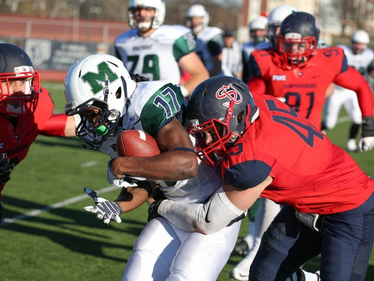 Shippensburg University's Cortlin Dell, right, tackles