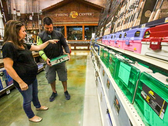 Kirstin and Al Martucci of Naples, shop with baby number seven on the way at Bass Pro Shops in Gulf Town Center in 2015. Black Friday has launched earlier this year.