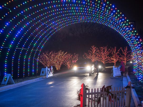 Visitors drive through the annual Lights at Gresham