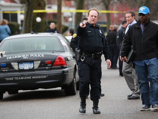 Dearborn Police Officer Brayman goes over the scene