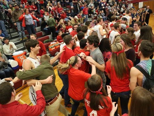 Shippensburg's players and fans celebrate a victory
