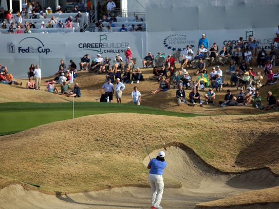 Golfers on the TPC Stadium Course 18th hole during