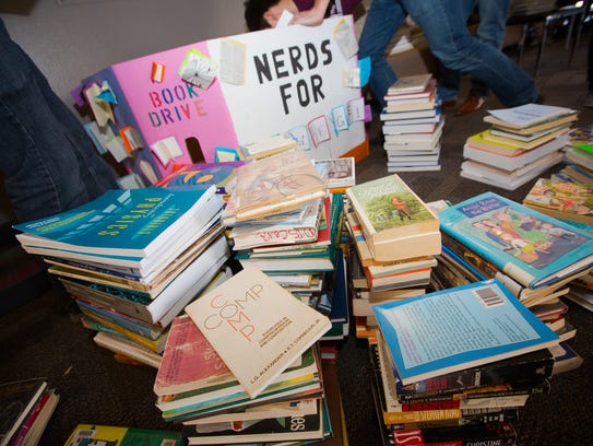 Donated books are piled up for the Nerds for Knowledge