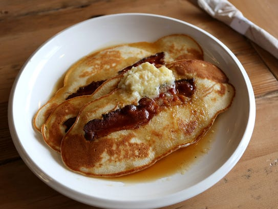 The bacon pancakes with apple butter and maple syrup