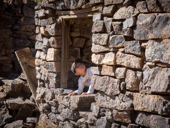 "5-year-old Noah Allen explores the crumbling ""Rock"