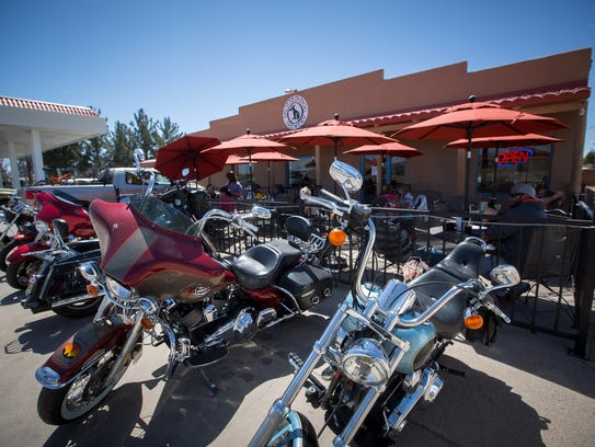 Motorcycles line the  the Spotted Dog Brewery's patio,