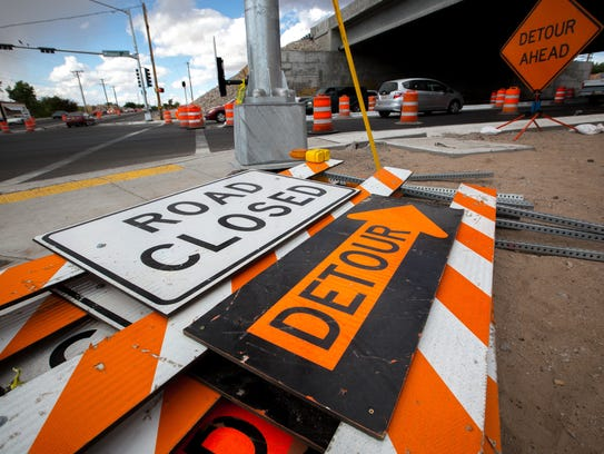 Road closure signs lay on the ground on the site of