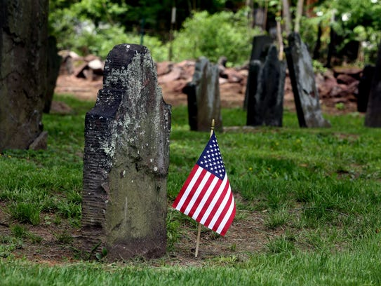 A flag is planted at the grave of a military veteran