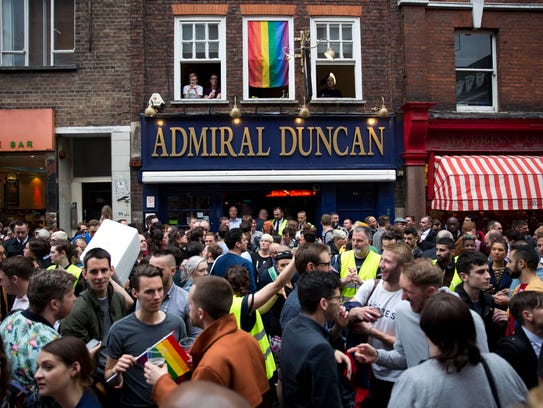 People gather outside the Admiral Duncan, a lesbian
