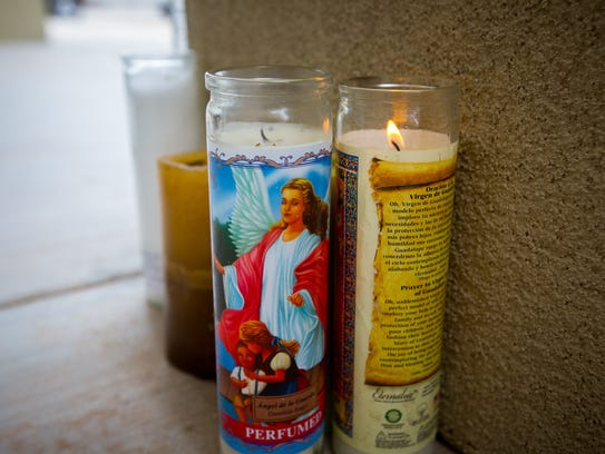 Devotional candles were left on Saturday, Aug. 13,