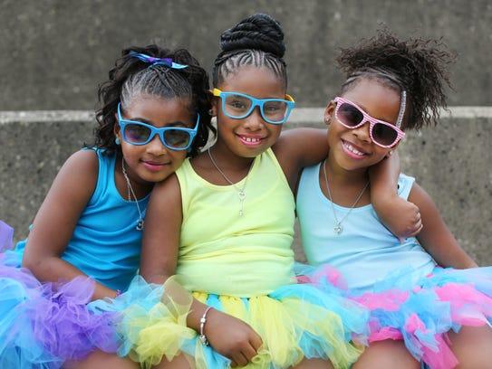 A young rap group, DPC Girlz, pose for a photo prior