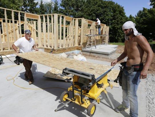 Rob Schumann and Tim Hansen, of Schumann Construction,