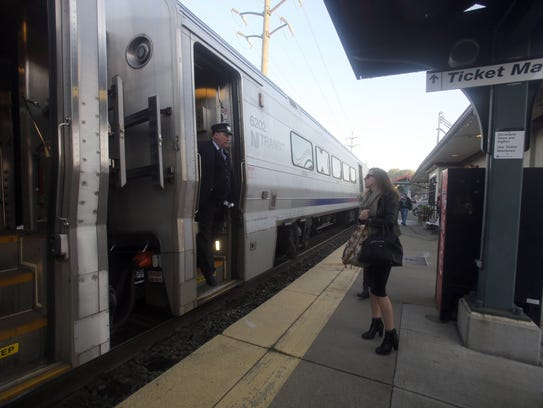 A passenger boards an NJ Transit Pascack Valley Line