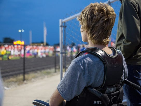 Caleb Kunckle, a senior with the football team, watches