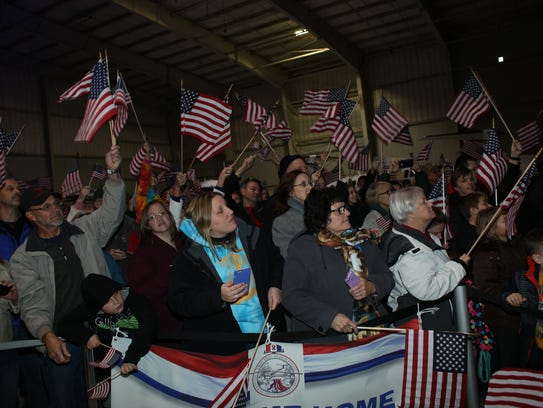 Crowds cheer the returning veterans at the Greater
