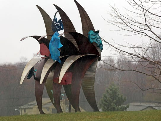 Wave sculpture by Anne Stanner is on the front lawn