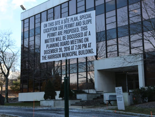 A planning board meeting sign in front of 106 Corporate