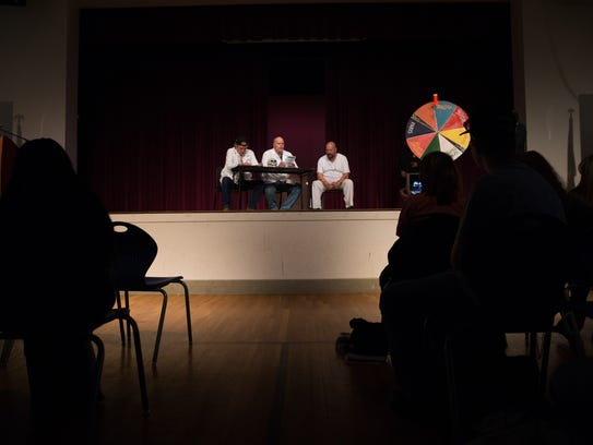 Students from Alma d'Arte Charter School watch a performance