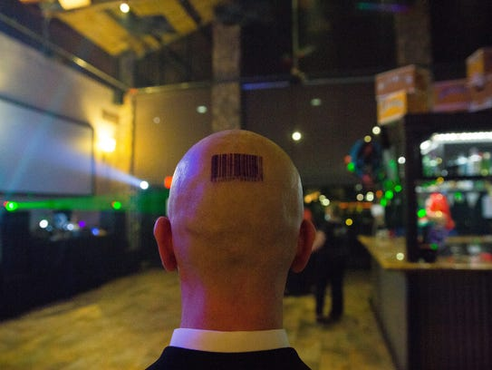 James Turquette, who Dj's as Res1, dressed as Agent