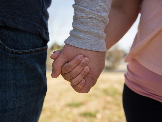 Jayce and Cindy McCormick, holding hands, talk about