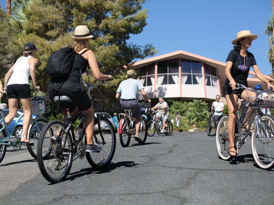 Cyclists stop by the Elvis Honeymoon House by William