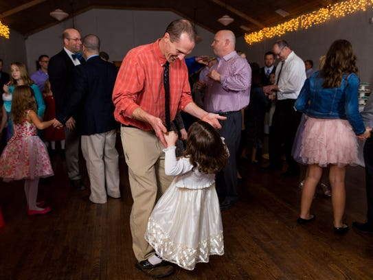 A scene from the Fletcher Father-Daughter Dance, which