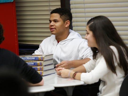 Justin Wimpish, 15, participates in a discussion on