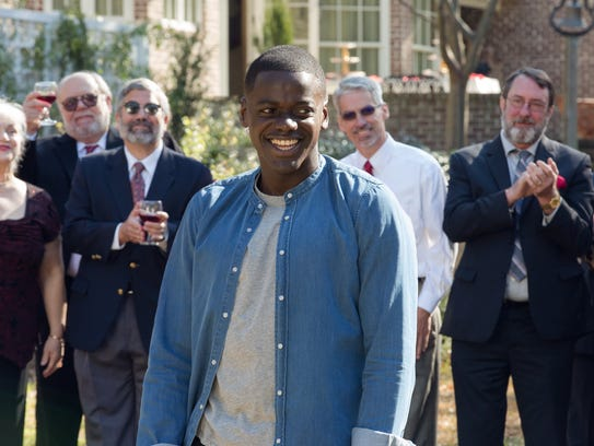 Chris Washington (Daniel Kaluuya) is the guest at a