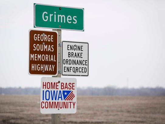 Home Base Iowa Community signs in Grimes, Iowa,  Tuesday