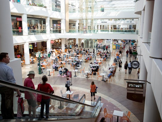 People sit at the food court in Scottsdale Fashion