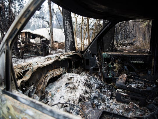 A home and vehicle on Le Buffs Road continues to smoke