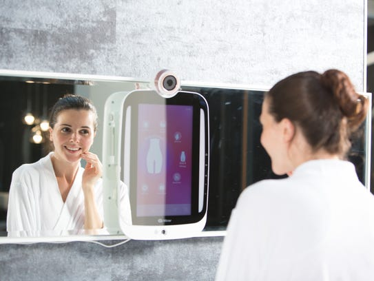 "This ""smart mirror"" analyzes your face and gives you"
