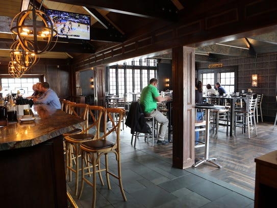 Patrons have lunch at the Mill House Brewing Company