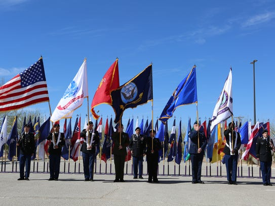 The Joint Task Force North Color Guard displays the