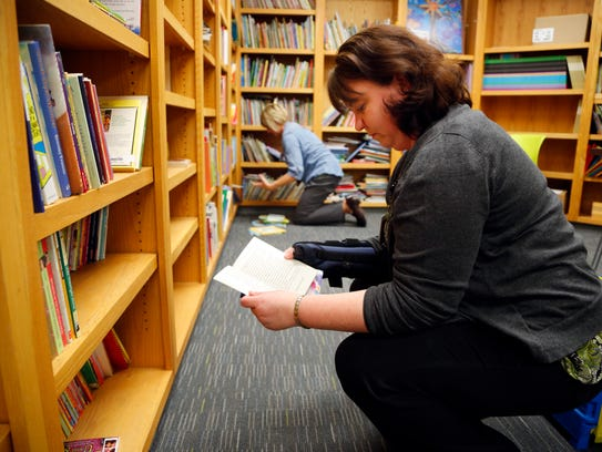 Tabby Kuehl and Kay Tannatt pick out books for the