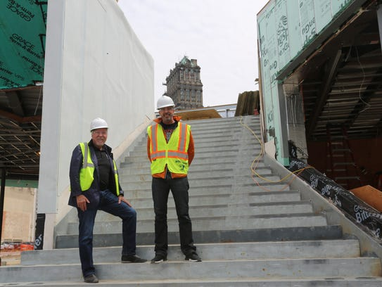 Norm LePage, left, and son Scott, stand on the grand