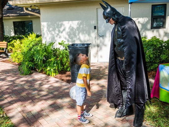 Giovanni Rodriguez, 4, of Naples talks with Batman