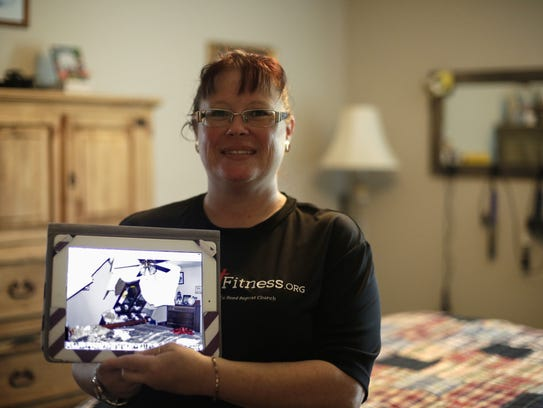 Kim Autry stands in her master bedroom, which was repaired