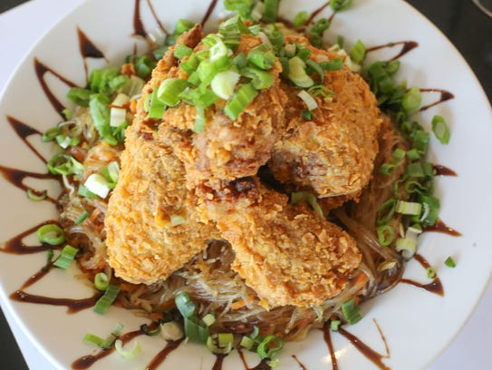 The adobo fried chicken with vegetable pancit at Evzin