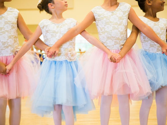 Students pause during a dance rehearsal on Thursday,