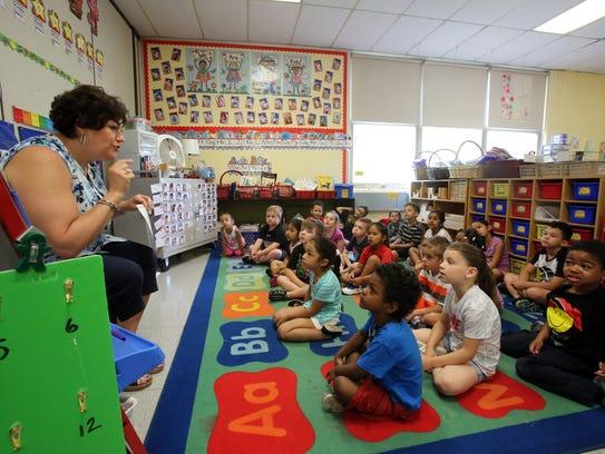 Kindergarten teacher Bernadette Stolz leads a consonant