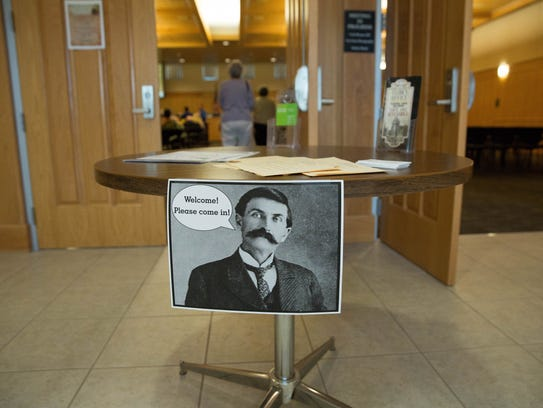 A photo of Pat Garrett welcomes people into the Doña