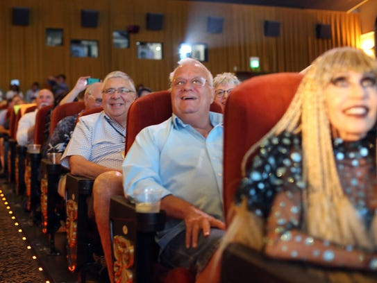 Audience members packed the Camelot Theater in Palm