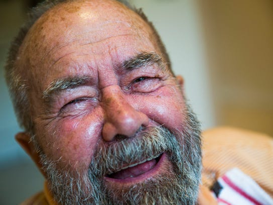 George Otto, 86, breaks out in to laughter while eating