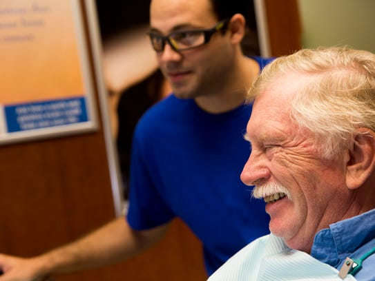 Vietnam veteran Ken Hulme smiles while chatting with